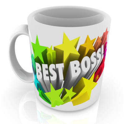 Best Boss words on a white ceramic coffee cup or mug as prize for the top leader, manager, employer, executive or supervisor in a workplace,  business or company